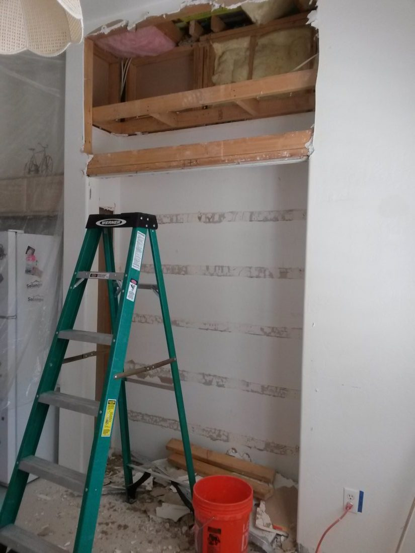 Removing the pantry to put more cabinets.