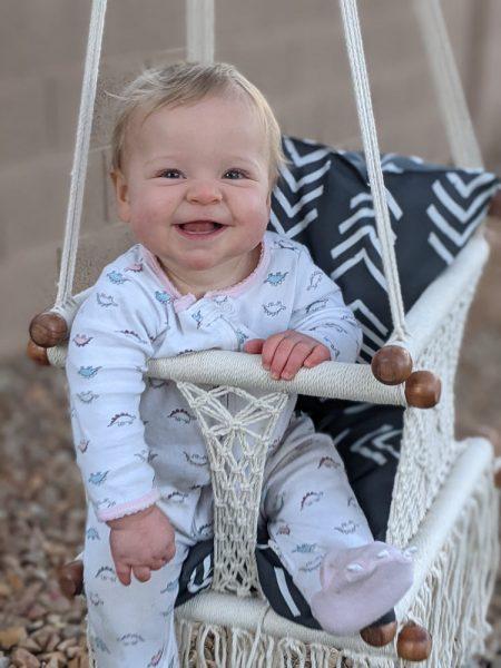 Mattie loves to swing!