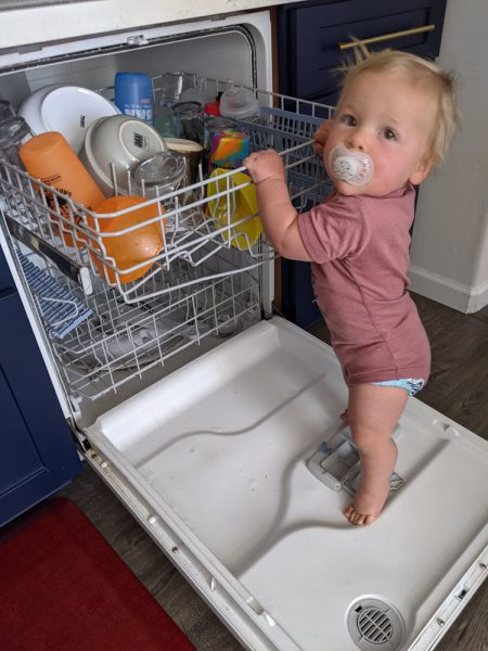 Helping unload the dishwasher